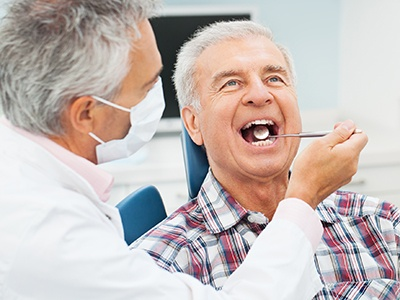 man receiving dental check-up